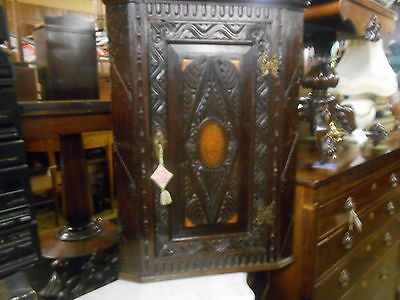 carved oak  corner cabinet inlaid shell design gothic looking storage 1800