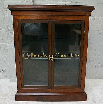 A 20th century mahogany 'Cadbury's Chocolate' display cabinet. Modern text graph