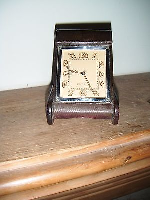 Jaeger Swiss 8-day 1930s Deco tooled-leather folding travel clock. Keeps time.