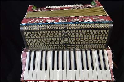Vintage Paolo Soprani Accordion. Red and Gold.