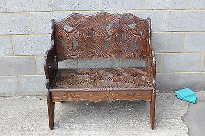 An Early 20th Century Carved Two Seat Bench