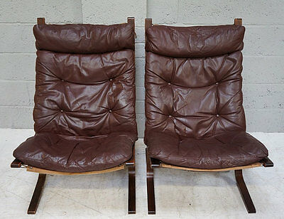 A pair of mid 20th century brown leather and bentwood easy arm chairs.
