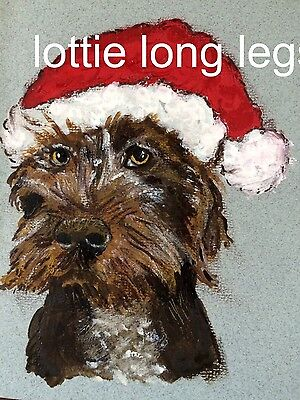 German Wirehaired pointer puppy wearing Santa's hat card
