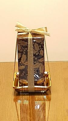 Pillar candle w/ black and gold holly pattern - ceramic holder - 6 inches approx