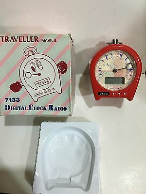 VINTAGE  TRAVELLER II CLOCK RADIO  IN RED AM(MW)- BAND FROM THE 1970s