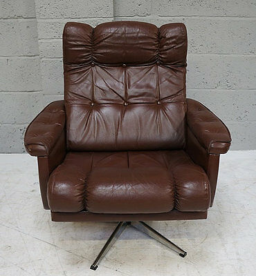 A mid - late 20th century light brown leather swivel arm chair on chrome base.