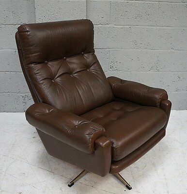 A mid - late 20th century dark brown leather swivel arm chair on chrome base.