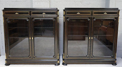 A late 19th - 20th century pair of ebonised and brass inlaid/ mounted cabinets.