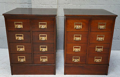 Late 19th - 20th century pair of mahogany multi-drawer chests with brass handles