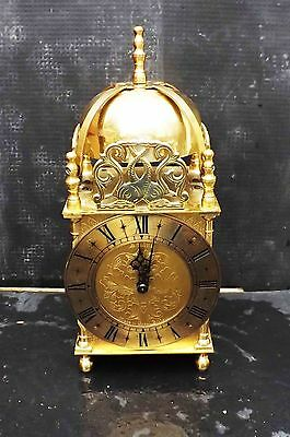 Lantern clock brass cased mechanical 8 day quality movement.
