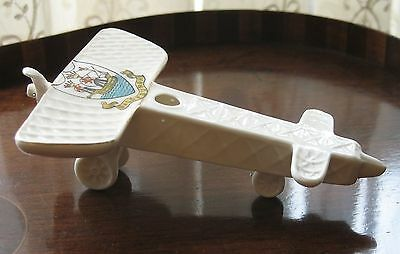Militaria :A scarce crested china model of an early Monoplane dating around 1914