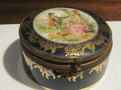Antique cobalt blue and gold porcelain powder trinket box with courting scene