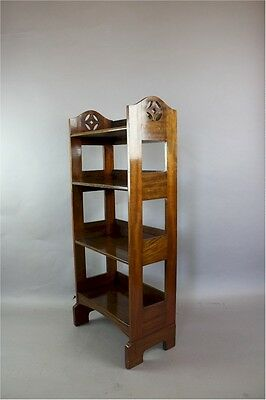 Arts and Crafts mahogany open bookcase with stylised cut-outs c1900