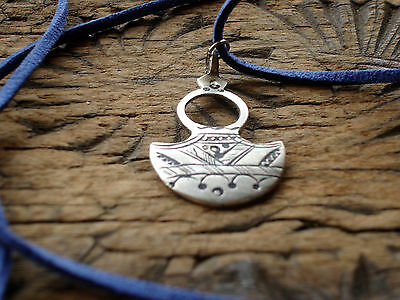 Moroccan  Tuareg hand engraved rounded pendant with blue tie