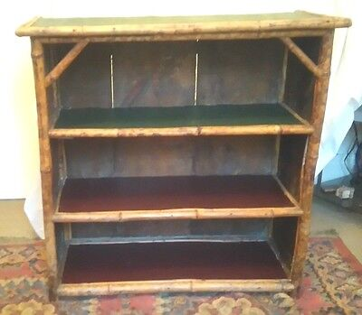 "VINTAGE BAMBOO BOOKCASE.Three Shelves covered in Faux Leather.31""hg. 35"" x 14.5"""