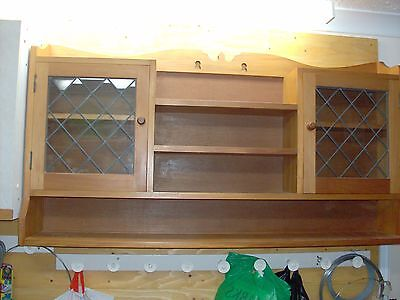 Arts and Crafts wood cabinet with leaded glass doors