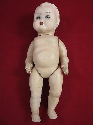 "Vintage bisque articulated doll with moveable eyes, 15"" tall"