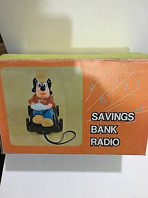 VINTAGE NOVELTY SAVING BANK AND RADIO AM(MW)- BAND FROM THE 1970s- 1980s