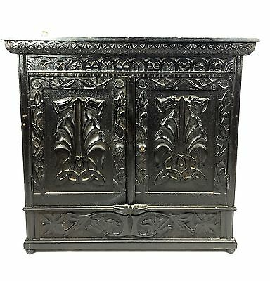 Wall hanging carved storage cupboard late 19th century/early 20th century