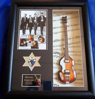 The Beatles Framed Miniature Tribute Guitar with Plectrum