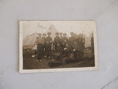 Rare WW1 postcard-group of soldiers posing in camp with civilians