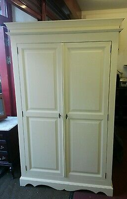 antique style pine wardrobe  finished in  cream paint