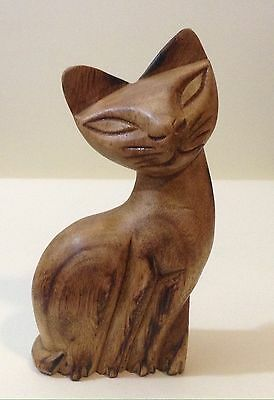 carved wooden cat figure