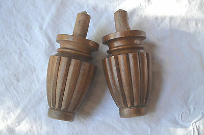 A pair of antique hand turned wooden finials