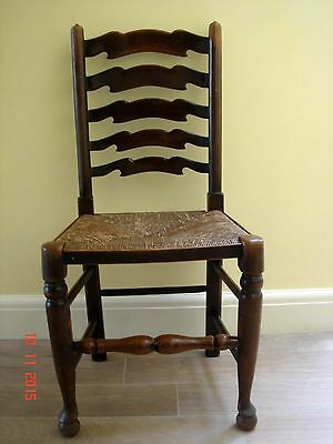 Traditional Antique Ladderback Chair With Rush Seat.