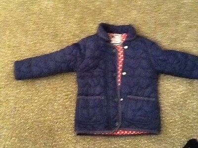girl navy quilted jacket age 3-4. trendy quality item pockets and spotty lining