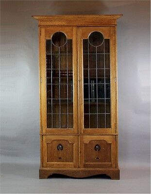Arts and Crafts oak glazed bookcase with pewter and ebony inlay