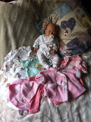 Reborn baby with clothes and accessories