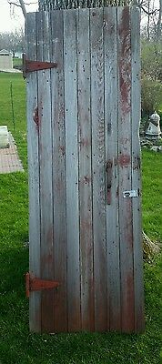 Vintage old rustic wooden barn door