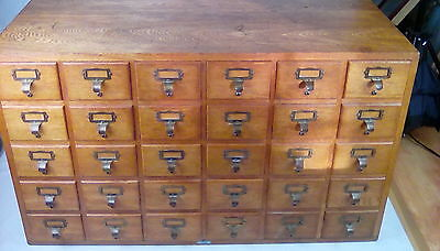 Oak Libraco bank of 30 library / filing drawers