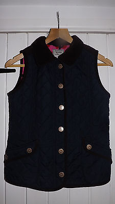 Children's Next navy quilted gilet with polka dot fleece lining. Age 11-12