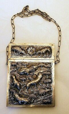 A solid silver card case with animals & trees, Indian c.1900.