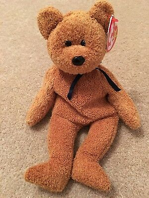 Fuzz the TY beanie baby bear . New with tags