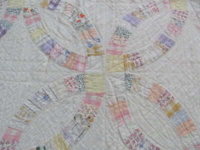 Vintage cutter hand quilted Double Wedding ring quilt