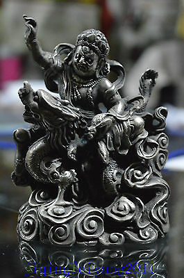 Chinese collectable Tibet Silver handwork carve god ride dragon unique statue