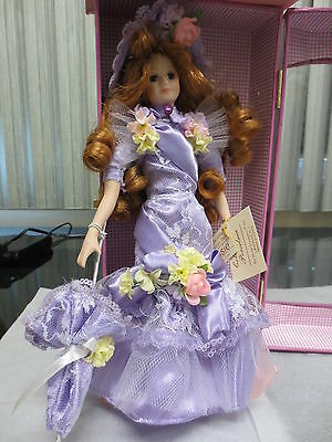 Show Stopperes Susie Collectible Porclain Doll w/case Purple outfit