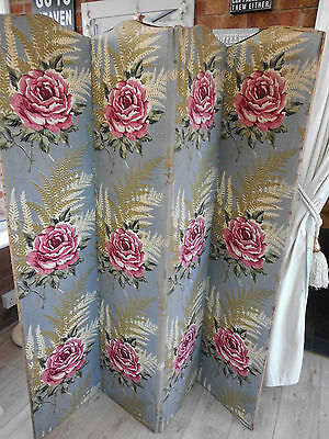 Vintage wooden screen covered in beautiful floral fabric