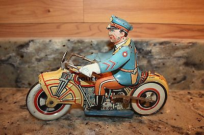 Vintage 1930's Unique Art Mfg. Co., Inc. Wind-Up Tin Toy Police On Motorcycle