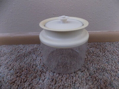 clear Tupperware jar container with push top lid