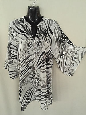 Lot of 6 oriental neckline chiffon tops.6 prints.Suit many sizes.Lovely quality