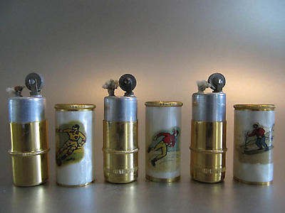 1950s: THREE NEW/OLD STOCK PETROL LIGHTERS WITH SOCCER, SKIER and SKATER