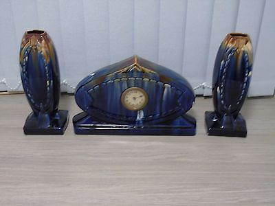 vintage pottery arts and craft style clock garniture