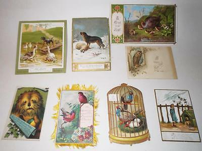 8 Victorian Christmas Cards featuring Dogs children birds bird cage