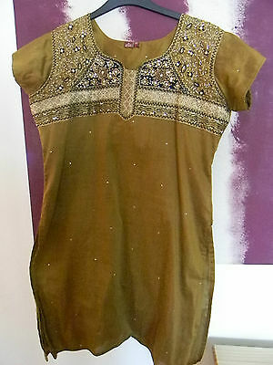 Rustic gold coloured indian suit with emboidery