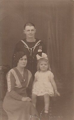 RPC Postcard: Post WW1 - Portrait of a British Sailor, Wife and Daughter