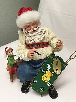 Possible Dreams Clothtique Santa Figurine On Bench with Elf Painting Sled